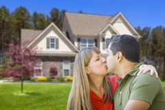 Mixed Race Couple Hugging in Front of House Royalty Free Stock Photos