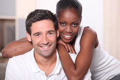 Mixed race couple indoors. Landscape portrait of a mixed race couple indoors Royalty Free Stock Photography
