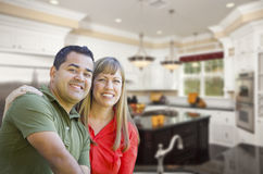 Mixed Race Couple Inside Beautiful Custom Kitchen Stock Images
