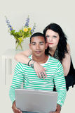 Mixed race couple on internet Stock Photo