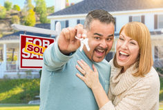 Mixed Race Couple With Keys in Front of Real Estate Sign and New Royalty Free Stock Images