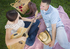 Mixed Race Couple at the Park Playing Guitar and Singing Royalty Free Stock Photo