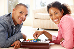 Mixed race couple playing solitaire Stock Images