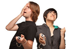 Mixed Race Couple Playing Video Game Remotes on White Royalty Free Stock Photo