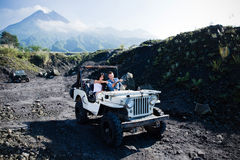 Mixed race couple riding a jeep off road Stock Images