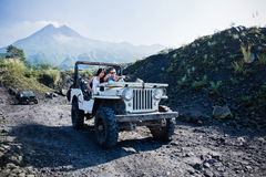 Mixed race couple riding a jeep off road Stock Photos