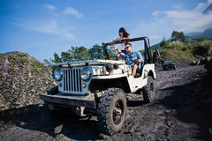 Mixed race couple riding a jeep off road Stock Photo