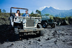 Mixed race couple riding a jeep off road Stock Image