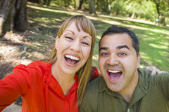 Mixed Race Couple Self Portrait at the Park Royalty Free Stock Image