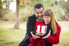 Mixed Race Couple Sharing Christmas or Valentines Day Gifts Stock Photo