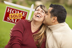 Mixed Race Couple and Sold Real Estate Sign Stock Photos