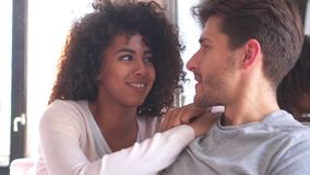 Mixed race couple talking at home stock video