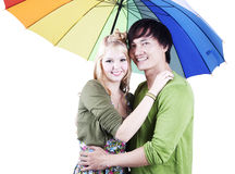 Mixed race couple with umbrella Stock Images