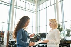 Mixed Race Customer in Car Showroom royalty free stock photography