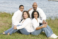 Mixed race family. Group portrait outside at a park Royalty Free Stock Photos
