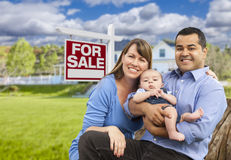 Mixed Race Family in Front of For Sale Sign and House Stock Photos