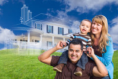 Mixed Race Family with Ghosted House Drawing Behind Stock Image