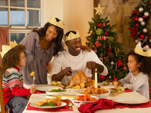 Mixed race family having Christmas dinner royalty free stock photography