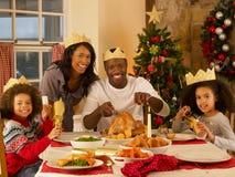 Mixed race family having Christmas dinner. Smiling at camera royalty free stock photo