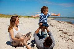 Mixed Race Family Having Fun Outdoors. Young mixed race family having fun on their summer vacation outdoors royalty free stock images