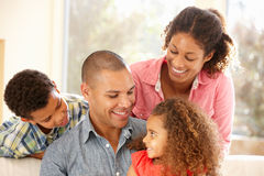 Mixed race family at home royalty free stock photo
