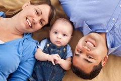 Mixed Race Family Lying on a Blanket Royalty Free Stock Photo