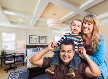 Mixed Race Family In New Custom Bedroom. Happy Mixed Race Family In New Custom Bedroom Royalty Free Stock Photo