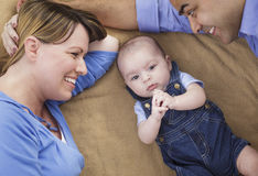 Mixed Race Family Playing on the Blanket Stock Photography