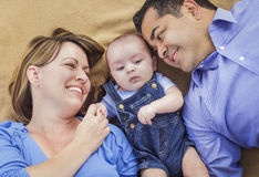 Mixed Race Family Playing on the Blanket Stock Photo