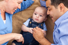 Mixed Race Family Playing on the Blanket Royalty Free Stock Image