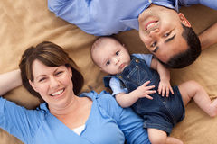 Mixed Race Family Playing on the Blanket Royalty Free Stock Images