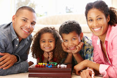 Mixed race family playing solitaire royalty free stock photography