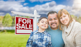 Mixed Race Family Portrait In Front of House and For Sale Real E Royalty Free Stock Photos