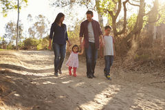 Mixed race family walking on rural path, front view Stock Images