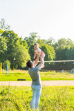 Mixed race father and baby daughter playing in the park stock photography