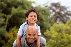 Mixed race father and son Stock Images