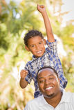Mixed Race Father and Son Cheering Stock Photo