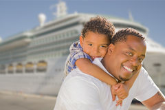 Mixed Race Father and Son In Front of Cruise Ship Stock Photos