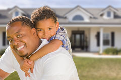 Mixed Race Father and Son In Front of House Stock Images