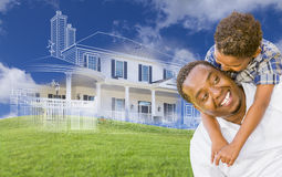Mixed Race Father and Son with Ghosted House Drawing Behind Stock Photo