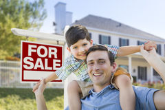 Mixed Race Father, Son Piggyback, Front of House, Sale Sign Stock Photos