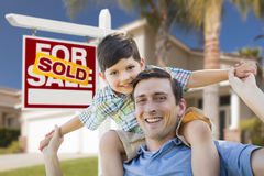 Mixed Race Father, Son Piggyback, Front of House, Sold Sign stock images