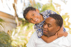 Mixed Race Father and Son Playing Piggyback Royalty Free Stock Photo