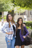 Mixed Race Female Couple Carrying Backpacks on School Campus Stock Image