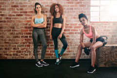 Mixed race female friends in gym Stock Photos