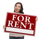 Mixed Race Female Holding For Rent Sign on White. Happy Mixed Race Female Holding For Rent Sign isolated on White royalty free stock image