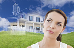 Mixed Race Female Looks Over to Ghosted House Drawing Behind Stock Photography