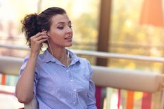Mixed race female performing business negotiations on video chat. Telecommuting concept. Businesswoman working remotely at cafe with headset and laptop. Mixed stock photos