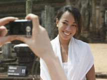 Mixed Race Female Posing For Photograph Outdoors Royalty Free Stock Images