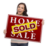 Mixed Race Female with Sold Home For Sale Sign. Happy Mixed Race Female with Sold Home For Sale Real Estate Sign Isolated on White Stock Photos
